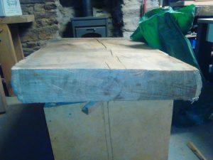 partie d'une bille de bois avant débit
